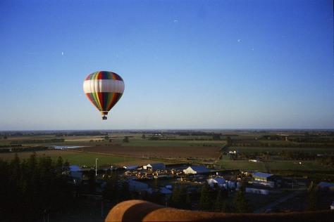 hot air balloon over village