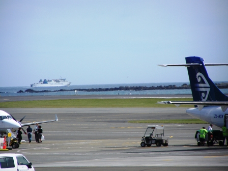 Check this - InterIslander and an Air NZ plane at Wellington