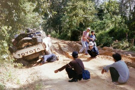 Rough road, overloaded truck (incl me on the back!) = broken axle in jungle