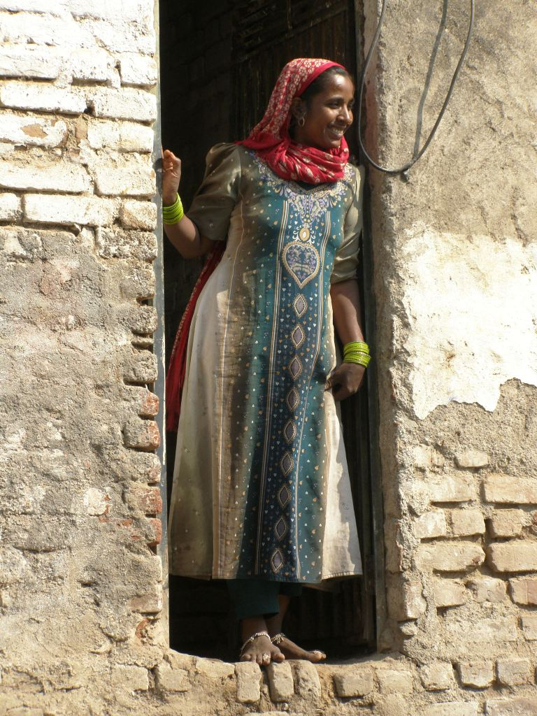 Young woman watches a parade in Maheshwar, India
