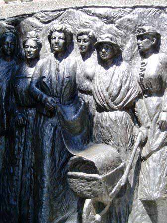 Detail of Kate and others with the petition in the wheelbarrow