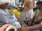 'Have a coffee with me' an old man indicates - I do. Oman.