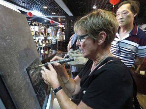 Janet attempts the carving .. much better than I was