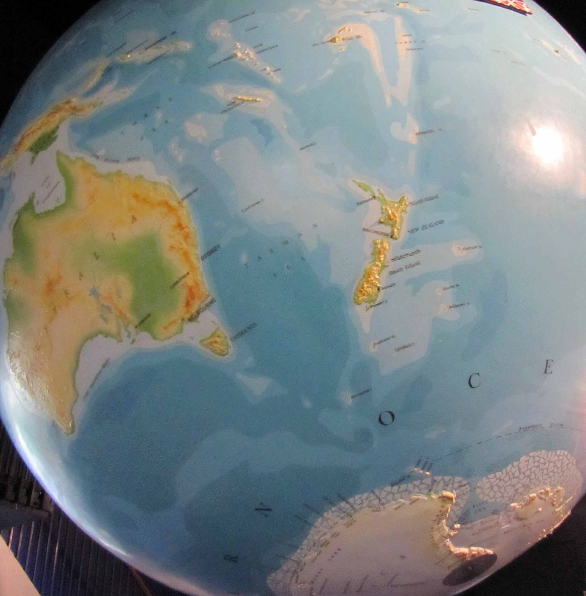 Where is new zealand on the map its disappeared kiwi travel photo of the globe globe showing new zealand antarctica and australia gumiabroncs Gallery