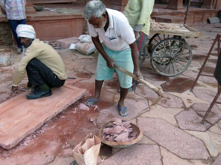 workmen laying tiles