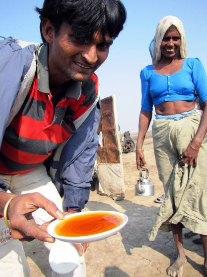I'm given some tea by a salt pan family. Gujarat